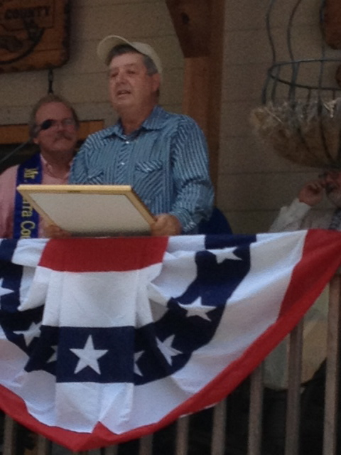 Retired County Supervisor Dave Goicoechea presents a Commendation from Assembly Representative Brian Dahle